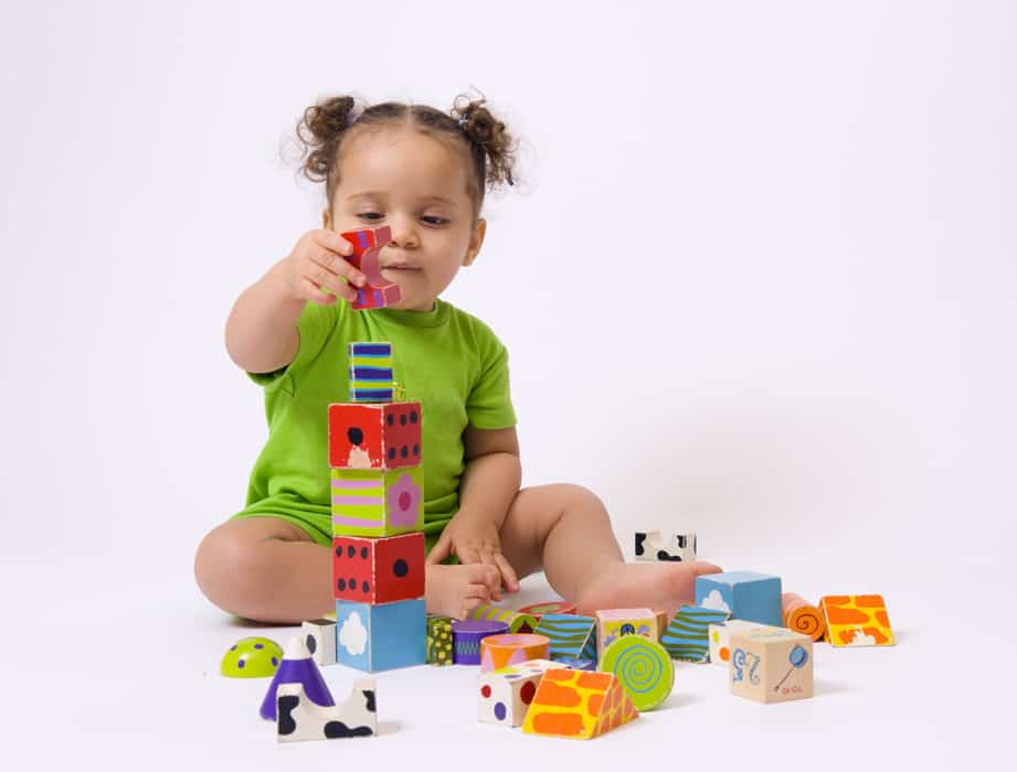 Toddler playing with ABA therapy learning materials